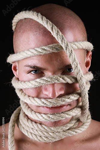 Portrait of a man with rope on his head