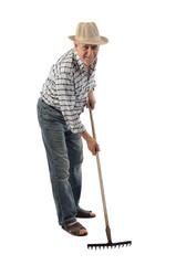 a farmer holds a rake