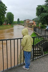 young child with waterproof watch with dismay the growing river