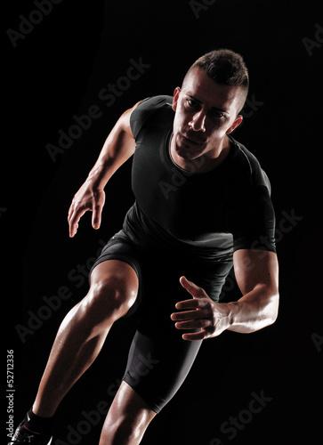 Fototapeta Hombre atleta corredor ejercitando.corriendo