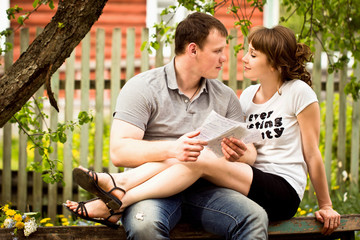 Loving couple sitting on a bench