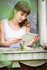 The girl reads the letter at a window