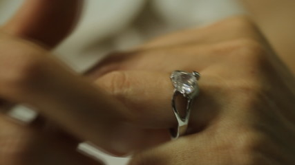 Divorce, a woman hand take off a diamond ring from the finger