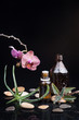 Herb leaf and Orchid with an aromatherapy essential oil