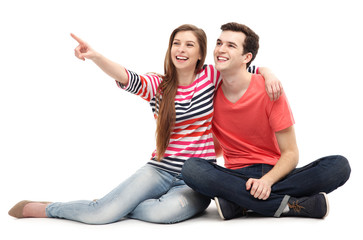 Young couple pointing