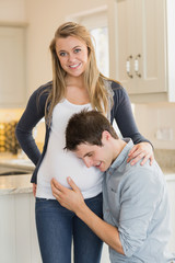 Smiling pregnant woman with  husband