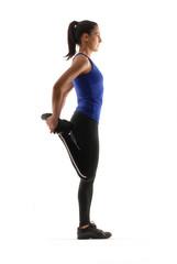 Joven mujer atlética en forma.ejercitando,estirando músculos.