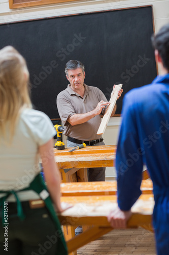 Explaining teacher and the woodwork class