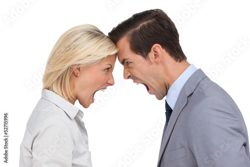 Colleagues quarreling head against head