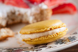 Delicious yellow macaron on a beautiful romantic dish