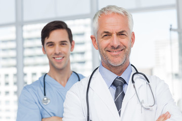 Two smiling doctors standing