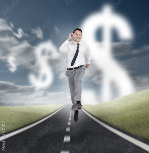 Businessman running on a road with dollars floating