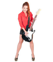 pretty woman in black shorts posing with guitar