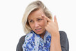Worried blonde pointing to forehead