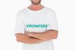 Man wearing volunteer tshirt with arms crossed