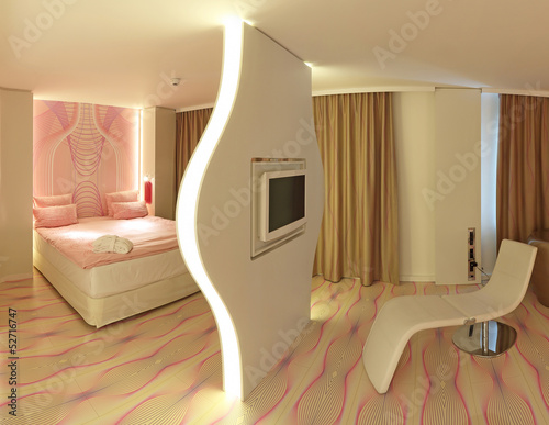 raumteiler bett und wohlf hlsessel mit fernseher von photowahn lizenzfreies foto 52716747. Black Bedroom Furniture Sets. Home Design Ideas