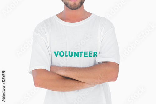 Man wearing volunteer tshirt with arms crossed