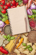 Assortment of fresh vegetables and recipe book