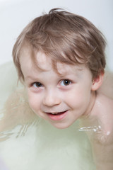 Boy bathing in bathtub
