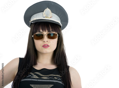 attractive woman in policeman cap and glasses