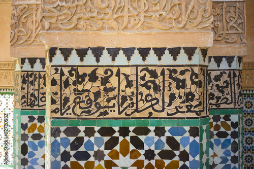 Detail of vivid tiles and calligraphy in mosque, Morocco