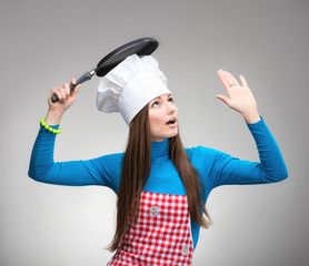 Woman with the pan under her head looks up and raises her hand