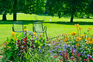 Chaise lounge for recreation near flowerbed