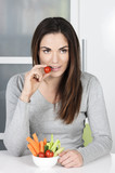 Cute girl eating healthy food