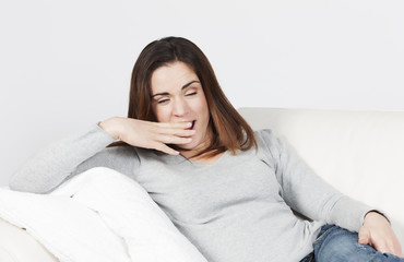 woman yawning on sofa
