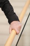 Senior Hand Grasps Wooden Railing poster