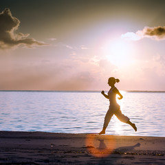 Caucasian woman jogging at the seashore