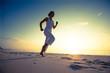 Caucasian woman jogging at seashore