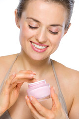 Beauty portrait of happy young woman with creme