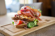 Tasty Parma Ham Sandwich On Wooden Plate