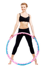Beautiful sporty woman with hula hoop