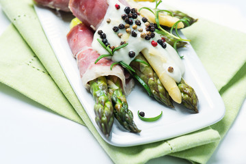 Green and white asparagus wrapped in prosciutto ham