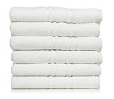 Stack of white hotel towels isolated on white background