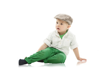 Trendy little boy in a cap