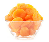 Glass bowl with dried apricots isolated on white