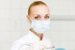 A portrait of a dental worker