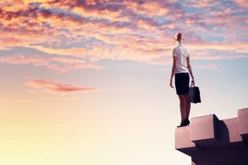 Businesswoman on top of building