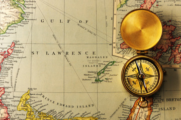Antique compass over old XIX century map