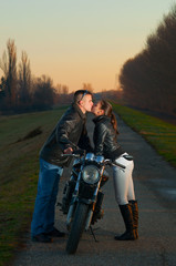 Couple kissing over the motorcycle