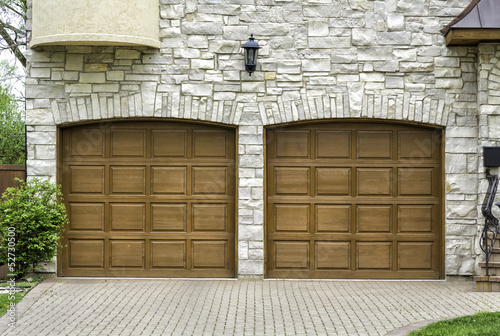 Leinwanddruck Bild Two car arch wooden garage