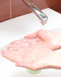 Washing of hands under running water