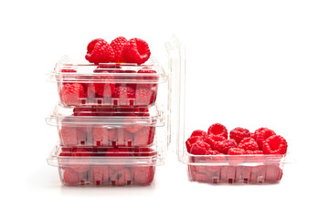 Red raspberries in plastic fruit containers