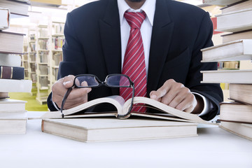 Businessman reading with glasses