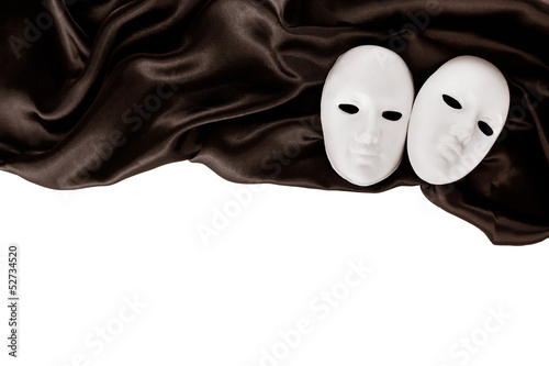 White masks and black silk fabric