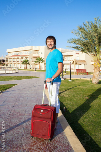 man arriving at Hotel with his luggage