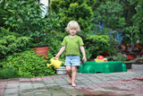 little barefoot girl  with watering can - portrait
